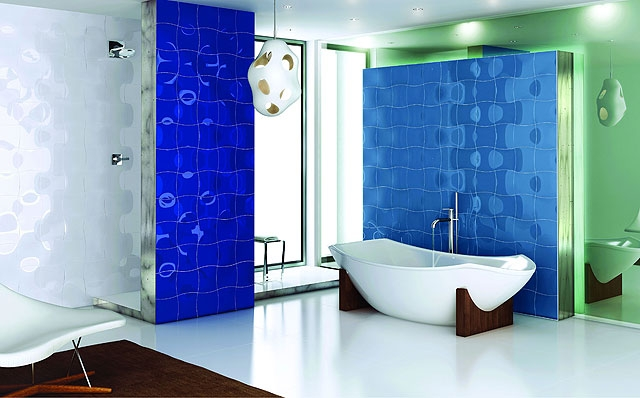 With-green-and-blue-colors-tiles-decorated-bathroom-furnished-with-white-chair-for-relaxation-and-modernistic-bathtub-with-white-color-and-faucet
